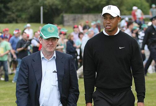 Tiger Woods with JP McManus (left) during the event in 2010. Photo: PA
