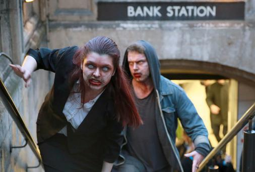 Actors dressed as zombies exit Bank Station in London as peer-to-peer lender RateSetter highlights the issue of 'zombie' savings accounts
