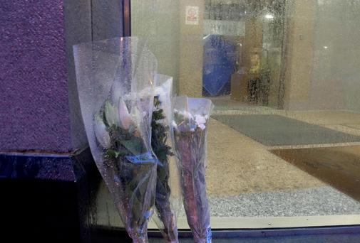 Flowers at Hynes Building Augustine Street Galway where Solomon Soremukun was killed Photo: Andrew Downes