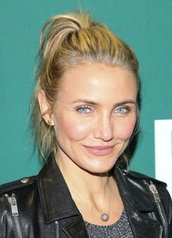"Cameron Diaz promotes her new book ""The Body Book: The Law of Hunger, the Science of Strength and Other Ways to Love Your Amazing Body"" at Barnes and Noble Union Square on January 6, 2014 in New York City. (Photo by Rob Kim/Getty Images)"