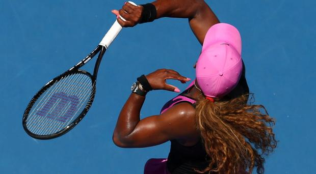 Serena Williams plays a forehand in her third round match against Daniela Hantuchova during day five of the 2014 Australian Open at Melbourne Park.