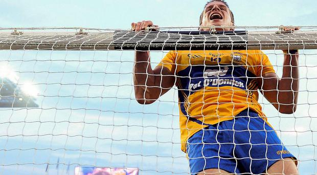 Clare's John Conlon jumps onto the crossbar in celebration at his team's victory against Cork in the All-Ireland SHC final in September