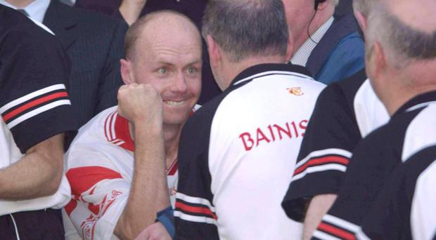 28 September 2003; Tyrone captain Peter Canavan celebrates with manager Mickey Harte after victory over Armagh. Photo: Matt Browne / Sportsfile.