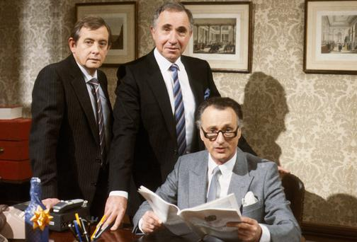 'I don't want the truth, I want something I can tell Parliament': Derek Fowlds as Bernard Wooley and Nigel Hawthorne as Sir Humphrey Appleby, civil servants to Paul Eddington's Minister James Hacker