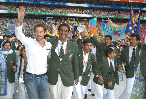 Hollywood star Colin Farrell leads out the Pakistan team at the opening ceremony of the 2003 Special Olympics in Croke Park.