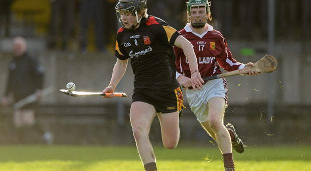 Cian O'Brien, Ard Scoil Ris, in action against Tommy Brett, Our Lady's Templemore