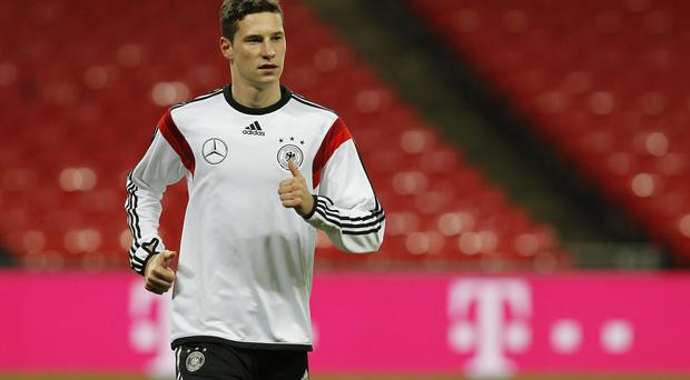 Julian Draxler of Germany warms up during a training session