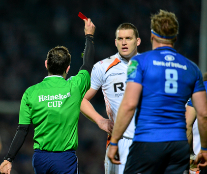 Ospreys' Ian Evans is shown a straight red card by referee Romain Poite.