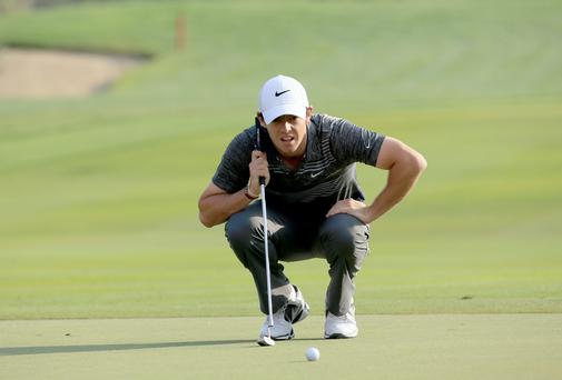 ABU Rory McIlroy of Northern Ireland lines up a bridie putt at the par 4, 17th hole during the third round of the 2014 Abu Dhabi HSBC Golf Championship at Abu Dhabi Golf Club.