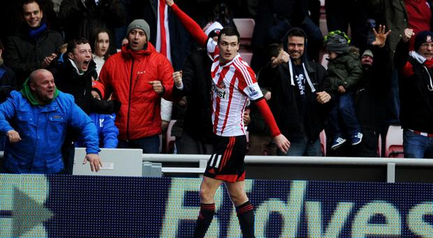 Adam Johnson celebrates as he scores their second goal during the Barclays Premier League match between Sunderland and Southampton at Stadium of Light