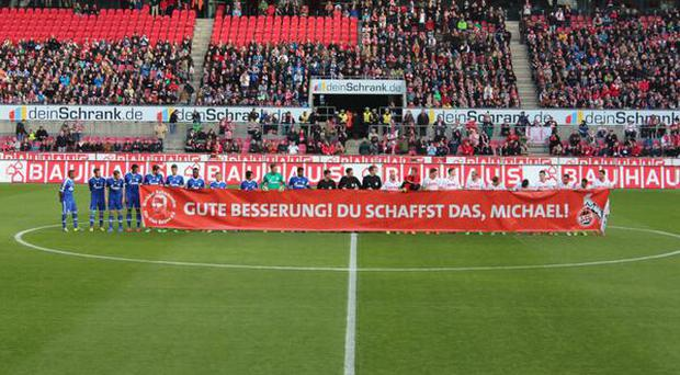 Schalke and Koln players offer their support to Michael Schumacher. Pic credit: @MariaCRuda