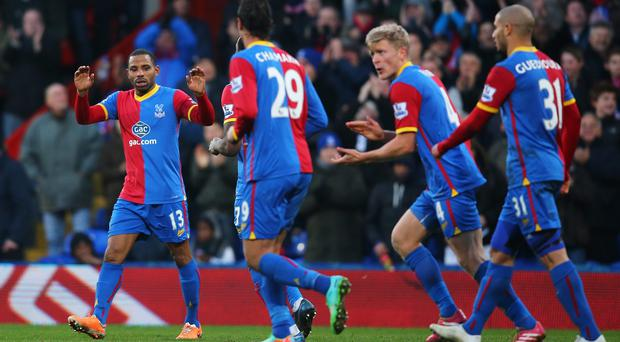 Jason Puncheon (L) of Crystal Palace celebrates scoring the opening goal with team mates during the Barclays Premier League match between Crystal Palace and Stoke City at Selhurst Park.
