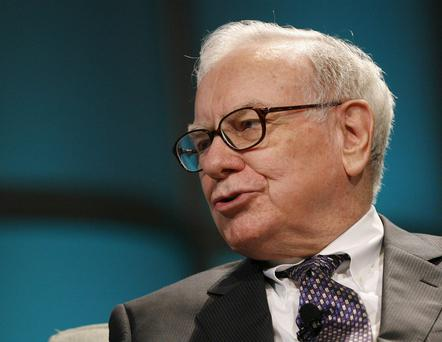 Warren Buffett, CEO of Berkshire Hathaway, addresses The Women's Conference 2008 in Long Beach, California in this file image from October 22, 2008. Stock futures added to gains on August 25, 2011 after Warren Buffett's Berkshire Hathaway Inc agreed to invest $5 billion in Bank of America Corp. S&P 500 futures rose 10.3 point and were above fair value, a formula that evaluates pricing by taking into account interest rates, dividends and time to expiration on the contract. Dow Jones industrial average futures added 87 points and Nasdaq 100 futures gained 0.5 point. REUTERS/Mario Anzuoni (UNITED STATES - Tags: BUSINESS HEADSHOT)