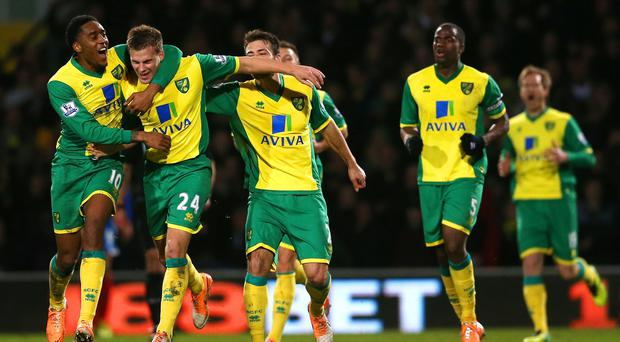 Leroy Fer of Norwich City congratulates Ryan Bennett on scoring the winning goal during the Barclays Premier League match between Norwich City and Hull City at Carrow Road.