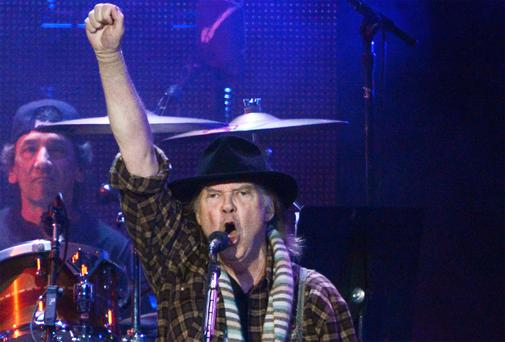 RETURN: Free-spirited Neil Young plays a gig in Cork in July. Photo: Kevork Djansezian/Getty
