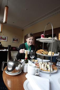 Afternoon tea: Geraldine Gittens samples afternoon tea at the Gresham Hotel. Photo: Ray Cullen.