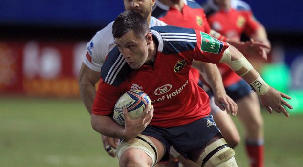 Munster's James Coughlan runs with the ball