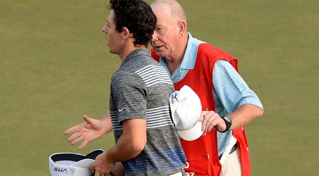 Caddy Dave Renwick advises Rory McIlroy not to sign his card after playing the 18th