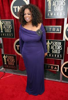 Oprah Winfrey arrives at the 20th annual Screen Actors Guild Awards.