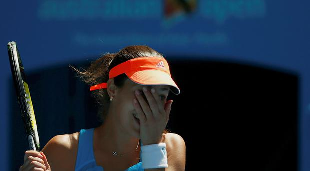 Ana Ivanovic of Serbia celebrates defeating Serena Williams of the United States in their women's singles match at the Australian Open 2014 tennis tournament in Melbourne