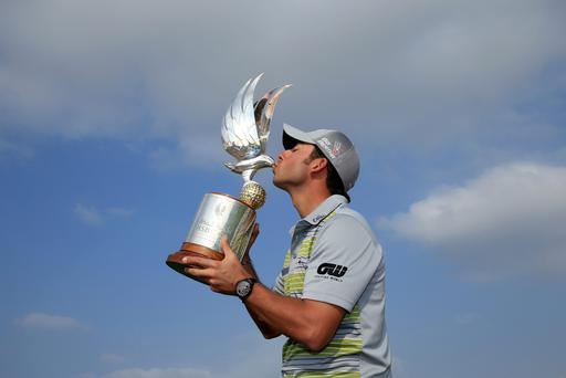 Pablo Larrazabal of Spain with the trophy after the final round of the 2014 Abu Dhabi HSBC Golf Championship at Abu Dhabi Golf Club