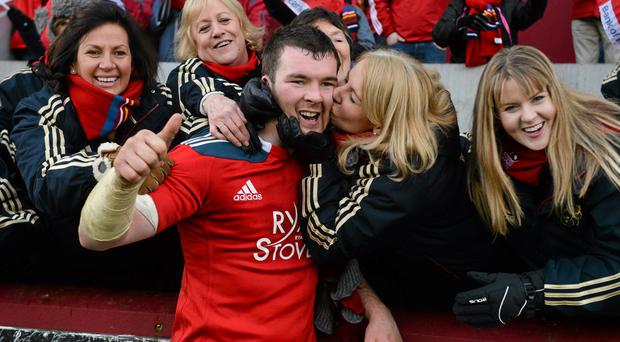 Munster captain Peter O'Mahony is congratulated by members of the Munster Rugby Supporters Choir after victory over Edinburgh.