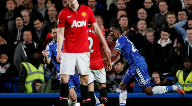 Chelsea's Samuel Eto'o (R) celebrates after scoring his side's second goal against Manchester United at Stamford Bridge