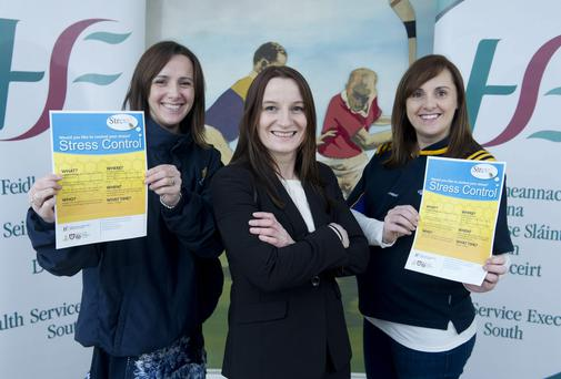 Janas Harrington and Claire Harrington from St. Finbarr's GAA Club with Dr. Jennifer Hayes Psychologist HSE South.