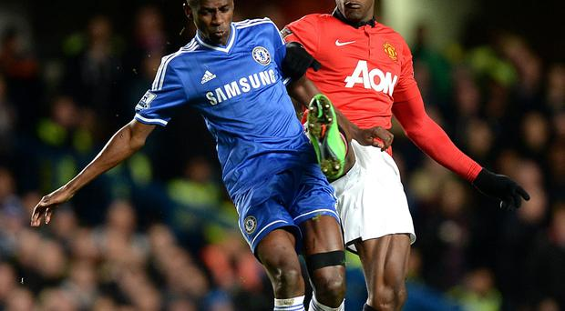 Manchester United's Danny Welbeck (right) and Chelsea's Ramires battle for the ball during the Barclays Premier League match at Stamford Bridge, London