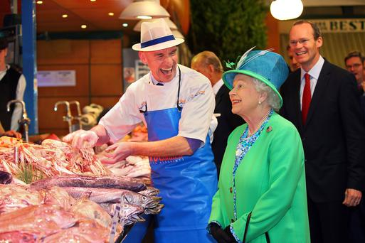 Queen Elizabeth meets fishmonger Pat O'Connell at his stall in the English Market in 2011