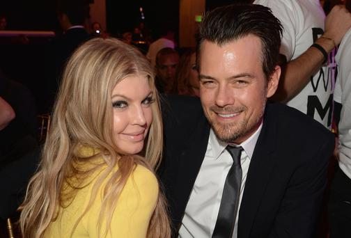Heels are history: Fergie, who says motherhood made her convert to flat shoes,with husband Josh Duhamel. Getty