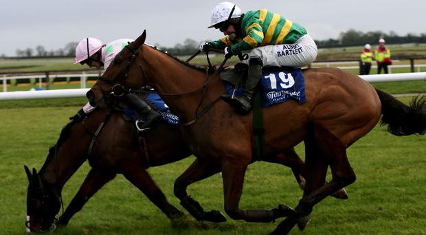 Waxies Dargle ridden by Tony McCoy (right) races clear of the last alongside Daneking ridden by Ruby Walsh