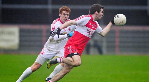 Benny Heron, Derry, in action against Peter Harte, Tyrone
