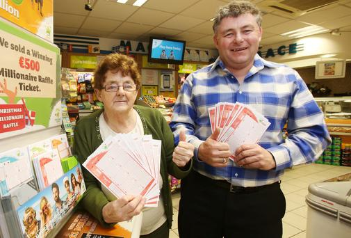 Martha and Joe Leahy of Newgate Stores in Navan, Co Meath, which sold one of the winning tickets. Picture: COLLINS