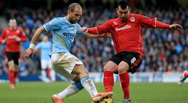 Pablo Zabaleta of Man City and Gary Medel of Cardiff compete for the ball