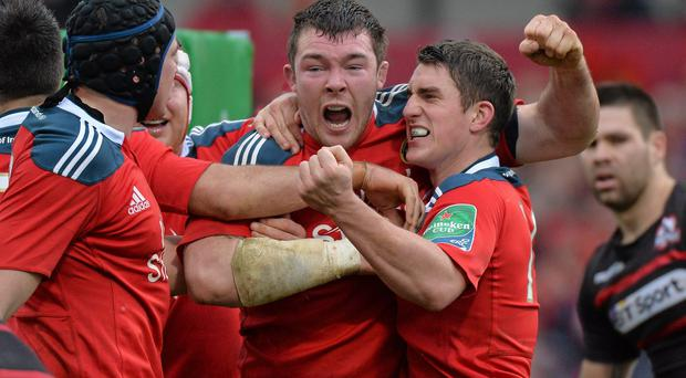 Peter O'Mahony, Munster, is congratulated by Ian Keatley, right, and Tommy O'Donnell