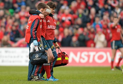 Keith Earls, Munster, leaves the field after picking up an injury in the first half