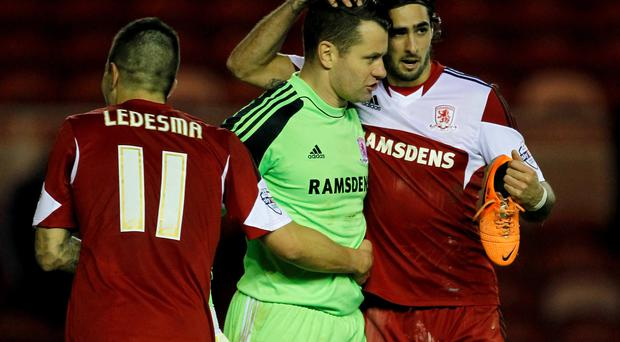Shay Given is congratulated by his Middlesbrough teammates after their 1-0 victory against Charlton on Saturday