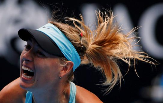 Maria Sharapova of Russia serves to Dominika Cibulkova of Slovakia during their women's singles match at the Australian Open