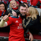 Munster captain Peter O'Mahony is congratulated by members of the Munster Rugby Supporters Choir after victory over Edinburgh. Heineken Cup 2013/14, Pool 6, Round 6, Munster v Edinburgh, Thomond Park, Limerick. Picture credit: Diarmuid Greene / SPORTSFILE
