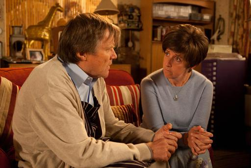 Hayley Cropper [JULIE HESMONDHALGH] silently looks out of the flat window as the world goes about its business knowing today is to be her last. Ironing Roy Cropper [DAVID NEILSON] best shirt, she asks him to wear it to her funeral. Clearly pained at the idea, Roy asks Hayley to reconsider but Hayley's mind is made up. Realising with dread that the time has come, Roy helps Hayley into bed but they're disturbed when Tyrone calls round looking for Ruby's toy kangaroo. Sensing things aren't right, Anna shuts the café and sits alone in the dark. Upstairs, Hayley prepares to take her lethal cocktail, telling Roy he must not touch the glass or have any part in it . Has Weatherfield's greatest love story come to end?