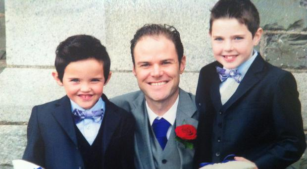 Stephen Carroll with his sons Senan, right and Keelan. Photo: Damien Eagers/ Evening Herald