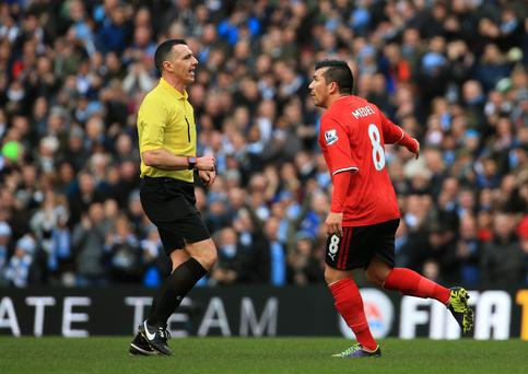 Gary Medel of Cardiff complains to referee Neil Swarbrick during the Barclays Premier League match between Manchester City and Cardiff City at the Etihad Stadium