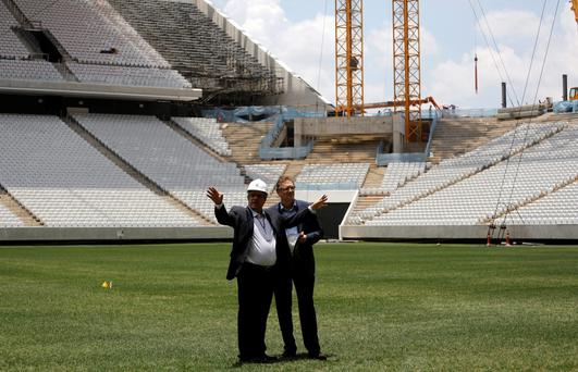 FIFA Secretary General Jerome Valcke (R) talks with an engineer during a visit to the site of the Arena Corinthians stadium, which is being prepared to host 2014 World Cup matches, in Sao Paulo January 20, 2014. Members from FIFA and the 2014 World Cup local organizing committee (LOC) are holding inspection tours to stadiums that will be hosting the 2014 World Cup games.