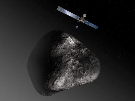 An artist's impression handout image by the European Space Agency shows the Rosetta orbiter deploying the Philae lander to comet 67P/ChuryumovGerasimenko. After a 10-year journey, the Rosetta spacecraft is due to end its hibernation today and prepare for an unprecedented mission to orbit the comet and dispatch a lander to the surface. The image is not to scale; the Rosetta spacecraft measures 32 m across including the solar arrays, while the comet nucleus is thought to be about 4 km wide. Photo: REUTERS/European Space Agency-C. Carreau/ATG medialab/Handout via Reuters