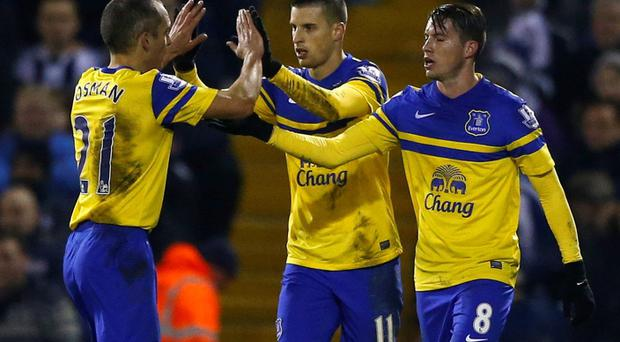 Everton's Kevin Mirallas (C) celebrates his goal against West Bromwich Albion with team mates Leon Osman (L) and Bryan Oviedo