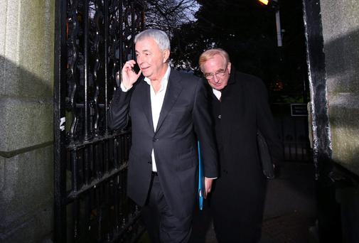 Paul Kiely (left) the former chief executive of the Dublin based Central Remedial Clinic and acting chief executive Jim Nugent (right) leaving Leinster House after giving evidence to The Public Accounts Committee. PRESS ASSOCIATION