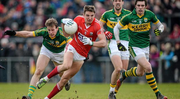 Aidan Walsh, Cork, breaks away from Donnchada Walsh, Kerry