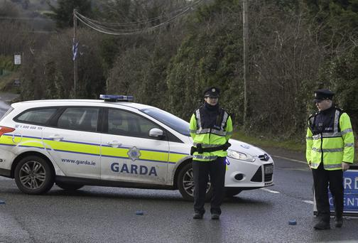 Members of the Gardai in the area where a body was found in Bohernabreena, Dublin. Photo: Gareth Chaney Collins
