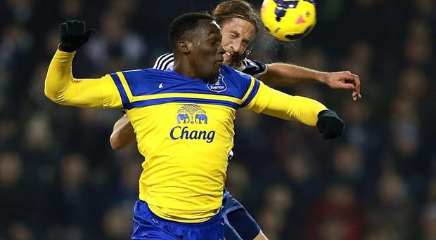 West Bromwich Albion's Jonas Olsson and Everton's Romelu Lukaku battle for the ball last night